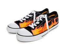 płomień kuje sneakers tenisowych Fotografia Stock
