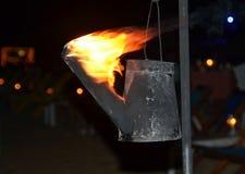Płomienna pochodnia tworząca od podlewanie puszki fotografii obrazy royalty free