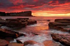 Płonąć wschód słońca od Avalon plaży Australia Zdjęcie Royalty Free
