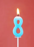 Płonąca wosk świeczka jak liczbę osiem Zdjęcia Stock