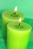 płonące świece zielone. Obraz Royalty Free