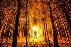 Płonący mężczyzna przy lasem Zdjęcia Stock