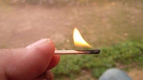 Płonący matchstick na ręce fotografia royalty free