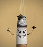 Płonący papieros i śmieszny charakter Obraz Stock