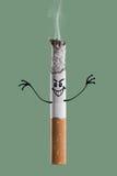 Płonący papieros i śmieszny charakter Zdjęcie Royalty Free