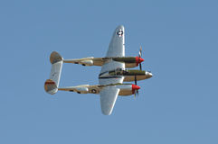 P-38 Flying Against Blue Sky Royalty Free Stock Image