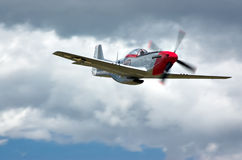 P-51 below clouds. P-51 Mustang fighter below cloud cover. Speed > 200 mph royalty free stock photo