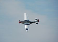 P-51 Mustang World War II fighter. Legendary P-51 Mustang fighter in flight at an airshow Royalty Free Stock Image