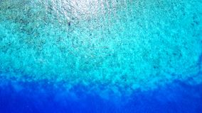 P02668 Aerial flying drone view of Maldives white sandy beach abstract waves water surface texture on sunny tropical Royalty Free Stock Image