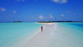 P02056 Aerial flying drone view of Maldives white sandy beach happy 1 person young beautiful young woman walking on. Aerial flying drone view of Maldives white stock images