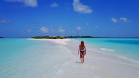 P02037 Aerial flying drone view of Maldives white sandy beach happy 1 person young beautiful young woman walking on. Aerial flying drone view of Maldives white royalty free stock photos