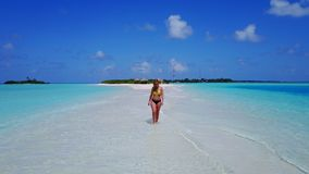 P02039 Aerial flying drone view of Maldives white sandy beach happy 1 person young beautiful young woman walking on. Aerial flying drone view of Maldives white stock photos