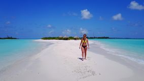P02049 Aerial flying drone view of Maldives white sandy beach happy 1 person young beautiful young woman walking on. Aerial flying drone view of Maldives white stock photography