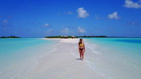 P02045 Aerial flying drone view of Maldives white sandy beach happy 1 person young beautiful young woman walking on. Aerial flying drone view of Maldives white stock photo