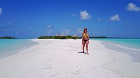 P02033 Aerial flying drone view of Maldives white sandy beach happy 1 person young beautiful young woman walking on. Aerial flying drone view of Maldives white royalty free stock photography