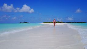 P02035 Aerial flying drone view of Maldives white sandy beach happy 1 person young beautiful young woman walking on. Aerial flying drone view of Maldives white stock image
