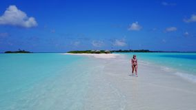 P02036 Aerial flying drone view of Maldives white sandy beach happy 1 person young beautiful young woman walking on. Aerial flying drone view of Maldives white stock photos