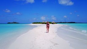 P02063 Aerial flying drone view of Maldives white sandy beach happy 1 person young beautiful young woman walking on. Aerial flying drone view of Maldives white stock photography