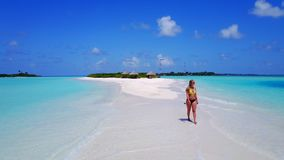 P02043 Aerial flying drone view of Maldives white sandy beach happy 1 person young beautiful young woman walking on. Aerial flying drone view of Maldives white stock images