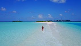 P02057 Aerial flying drone view of Maldives white sandy beach happy 1 person young beautiful young woman walking on. Aerial flying drone view of Maldives white royalty free stock image