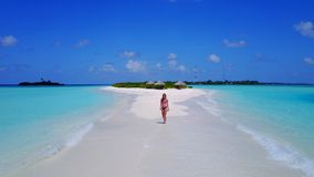 P02053 Aerial flying drone view of Maldives white sandy beach happy 1 person young beautiful young woman walking on. Aerial flying drone view of Maldives white royalty free stock image