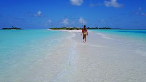 P02061 Aerial flying drone view of Maldives white sandy beach happy 1 person young beautiful young woman walking on. Aerial flying drone view of Maldives white stock photography