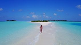 P02058 Aerial flying drone view of Maldives white sandy beach happy 1 person young beautiful young woman walking on. Aerial flying drone view of Maldives white stock photos