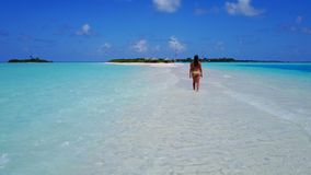 P02062 Aerial flying drone view of Maldives white sandy beach happy 1 person young beautiful young woman walking on. Aerial flying drone view of Maldives white royalty free stock photography