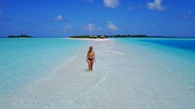 P02041 Aerial flying drone view of Maldives white sandy beach happy 1 person young beautiful young woman walking on. Aerial flying drone view of Maldives white royalty free stock photos