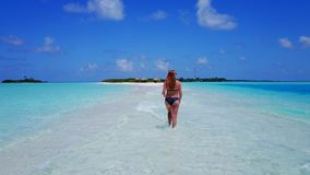 P02060 Aerial flying drone view of Maldives white sandy beach happy 1 person young beautiful young woman walking on. Aerial flying drone view of Maldives white royalty free stock photo