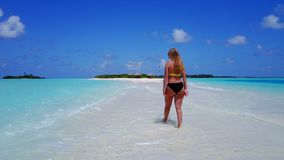 P02064 Aerial flying drone view of Maldives white sandy beach happy 1 person young beautiful young woman walking on. Aerial flying drone view of Maldives white royalty free stock photography