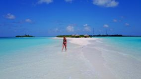 P02048 Aerial flying drone view of Maldives white sandy beach happy 1 person young beautiful young woman walking on. Aerial flying drone view of Maldives white royalty free stock images