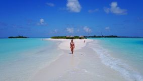 P02038 Aerial flying drone view of Maldives white sandy beach happy 1 person young beautiful young woman walking on. Aerial flying drone view of Maldives white royalty free stock image