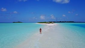 P02059 Aerial flying drone view of Maldives white sandy beach happy 1 person young beautiful young woman walking on. Aerial flying drone view of Maldives white royalty free stock photo