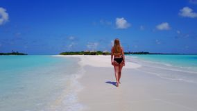 P02050 Aerial flying drone view of Maldives white sandy beach happy 1 person young beautiful young woman walking on. Aerial flying drone view of Maldives white royalty free stock photos