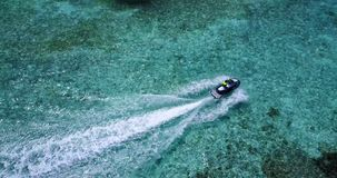 P01175 Aerial flying drone view of Maldives white sandy beach jetski riding sunny tropical paradise island with aqua. Aerial flying drone view of Maldives white Royalty Free Stock Image