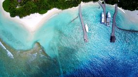P02589 Aerial flying drone view of Maldives white sandy beach luxury 5 star resort hotel relaxing holiday vacation on Stock Photography