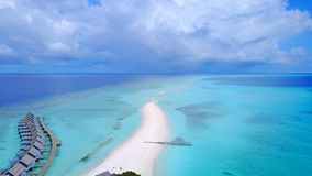P00133 Aerial flying drone view of Maldives white sandy beach luxury 5 star resort hotel water bungalows relaxing holiday vacation Royalty Free Stock Photos