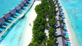 P00138 Aerial flying drone view of Maldives white sandy beach luxury 5 star resort hotel water bungalows relaxing holiday vacation Royalty Free Stock Photos