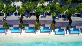 P00134 Aerial flying drone view of Maldives white sandy beach luxury 5 star resort hotel water bungalows relaxing holiday vacation Royalty Free Stock Images