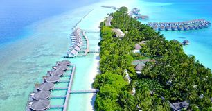 P00140 Aerial flying drone view of Maldives white sandy beach luxury 5 star resort hotel water bungalows relaxing holiday vacation Royalty Free Stock Images