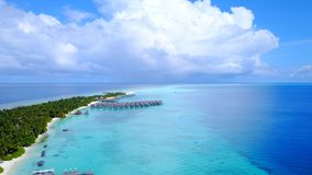 P00132 Aerial flying drone view of Maldives white sandy beach luxury 5 star resort hotel water bungalows relaxing holiday vacation Royalty Free Stock Photo