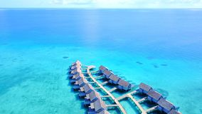 P00129 Aerial flying drone view of Maldives white sandy beach luxury 5 star resort hotel water bungalows relaxing holiday vacation Stock Images