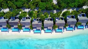 P00128 Aerial flying drone view of Maldives white sandy beach luxury 5 star resort hotel water bungalows relaxing holiday vacation Stock Photography