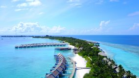 P00131 Aerial flying drone view of Maldives white sandy beach luxury 5 star resort hotel water bungalows relaxing holiday vacation Stock Photo