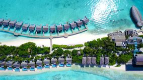 P00137 Aerial flying drone view of Maldives white sandy beach luxury 5 star resort hotel water bungalows relaxing holiday vacation Stock Photos