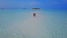 P02217 Aerial flying drone view of Maldives white sandy beach 2 people young couple man woman romantic love on sunny Stock Photos