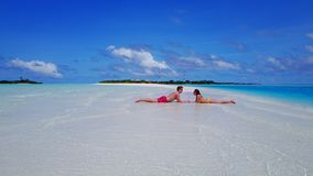P02534 Aerial flying drone view of Maldives white sandy beach 2 people young couple man woman romantic love on sunny Royalty Free Stock Photos