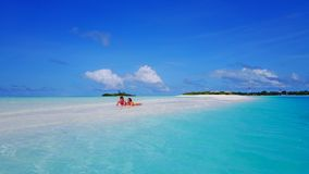 P02526 Aerial flying drone view of Maldives white sandy beach 2 people young couple man woman romantic love on sunny Stock Photo