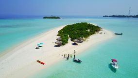 P01027 Aerial flying drone view of Maldives white sandy beach on sunny tropical paradise island with aqua blue sky sea. Aerial flying drone view of Maldives royalty free stock photo